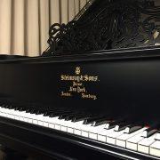 restored antique grand piano